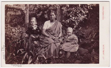 Victorian-era sepia photo of an Indian woman and two white children.